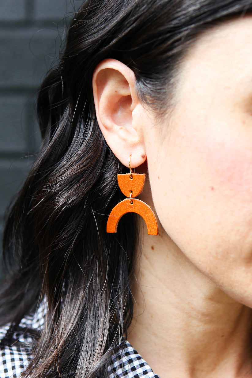all leather arch earrings