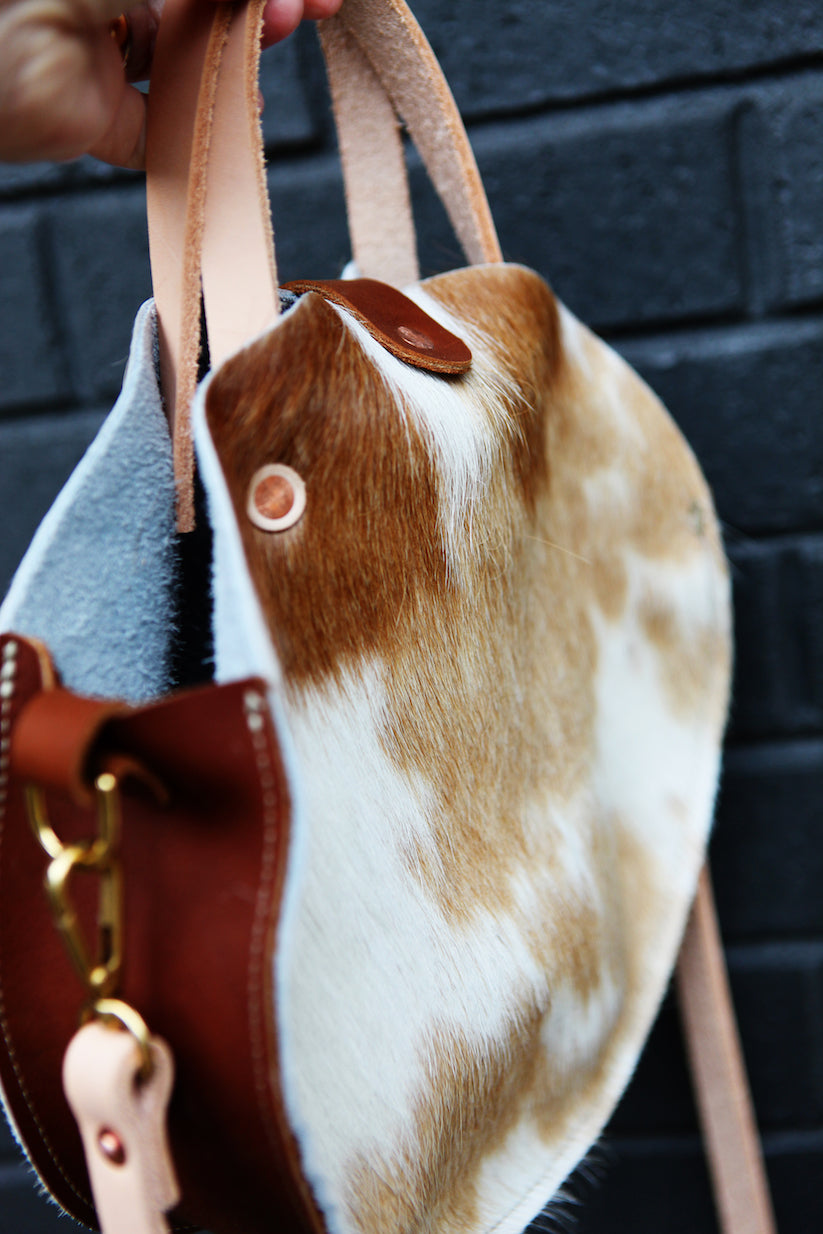the roundabout crossbody, brown + white hide