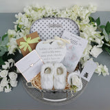 baby shower hamper with silver bracelet, white booties and heart plaque