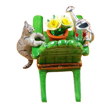 "Load image into Gallery viewer, Rochard ""Adirondack Chair with Cat, Watering Can & Plant"" Limoges Box"
