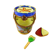 "Load image into Gallery viewer, Rochard ""Beach Pail with Sailboat & Shovel"" Limoges Box"
