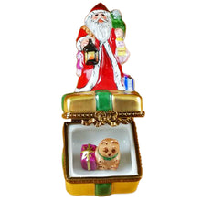 "Load image into Gallery viewer, Rochard ""Santa on Box with Gifts and Lantern"" Limoges Box"