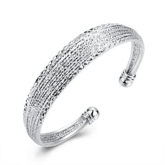 X Diamond Cut Bangle in 18K White Gold Plated