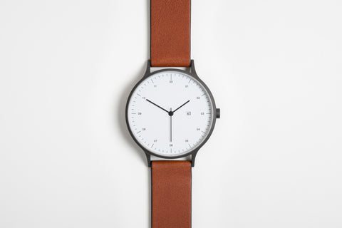 brown watch and strap