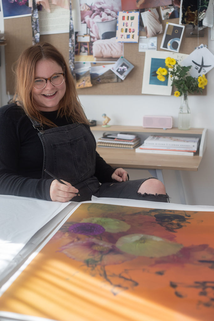 "Stacey Weaver signing work from ""Ophelia"" collection. Available exclusively through Studio Home ART HOUSE"
