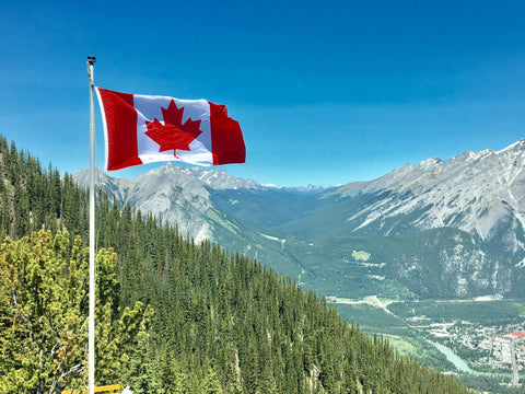 Canadian Flag in Front of Landscape - KryptoKratom.com