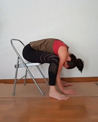 kurmasana on chair
