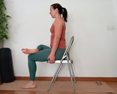 half lotus pose on chair