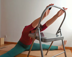 back extension in forward bend yoga chair
