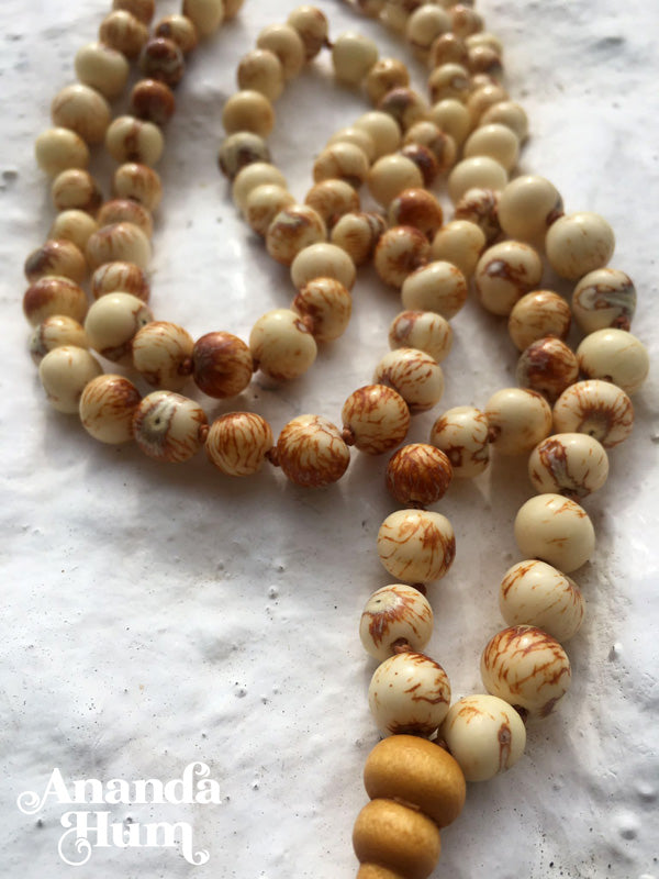 mala acai and arbovitae beads beige