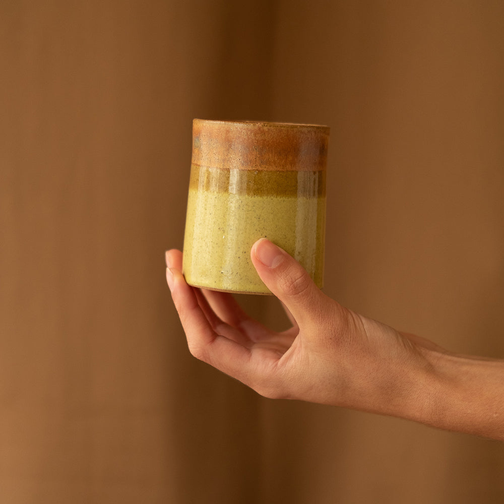 Short yellow and brown ceramic tumbler