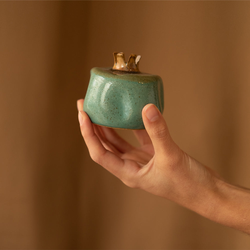 Green and brown ceramic pomegranate