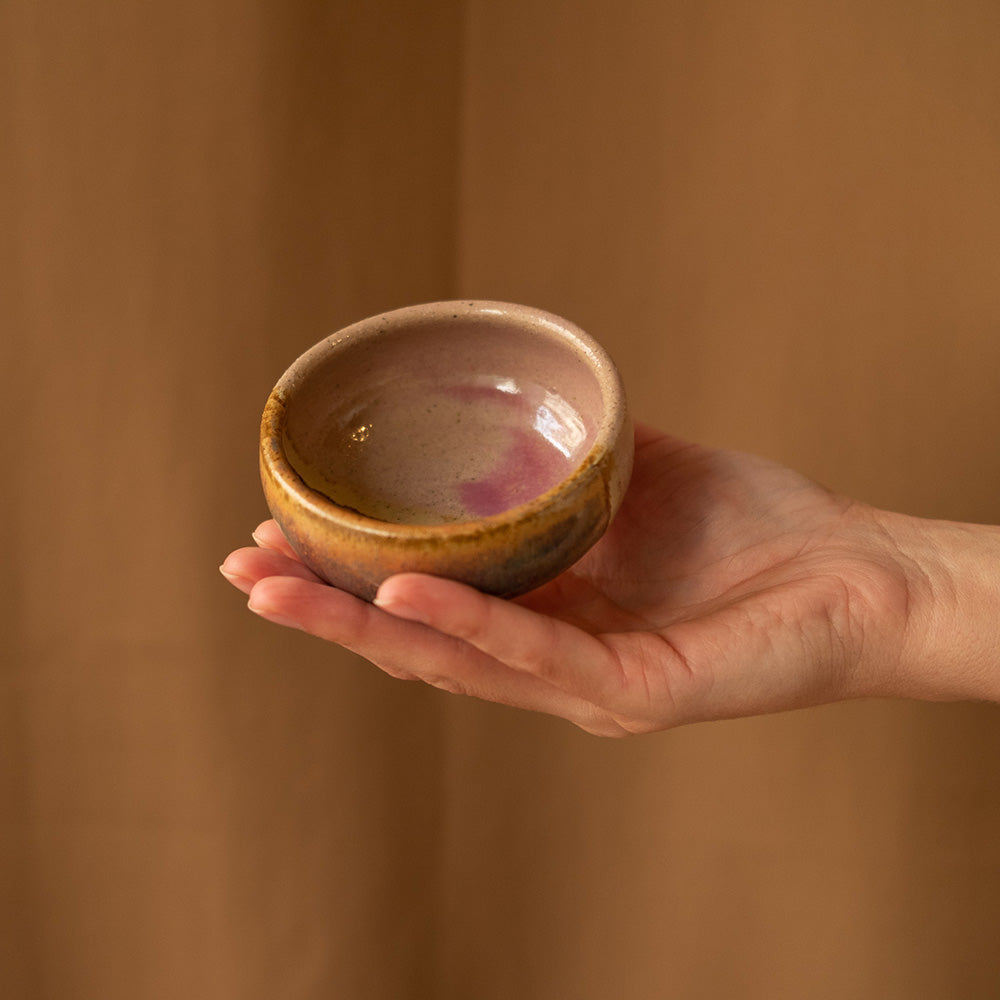 Purple and brown ceramic dip bowl