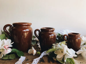 Three Vintage Slip Glazed Earth-ware Jugs (sold separately)