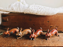 Load image into Gallery viewer, Set of Four Vintage Jumping Hares and Hutch