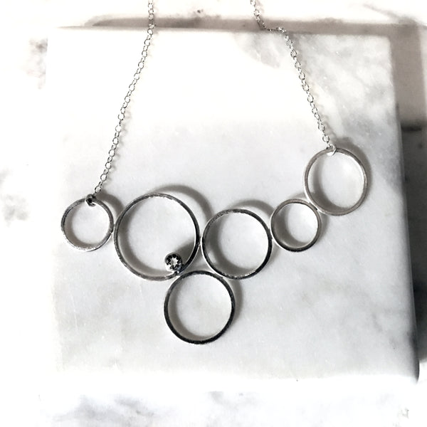 Cecile sterling silver circle necklace with gemstone by eko jewelry design