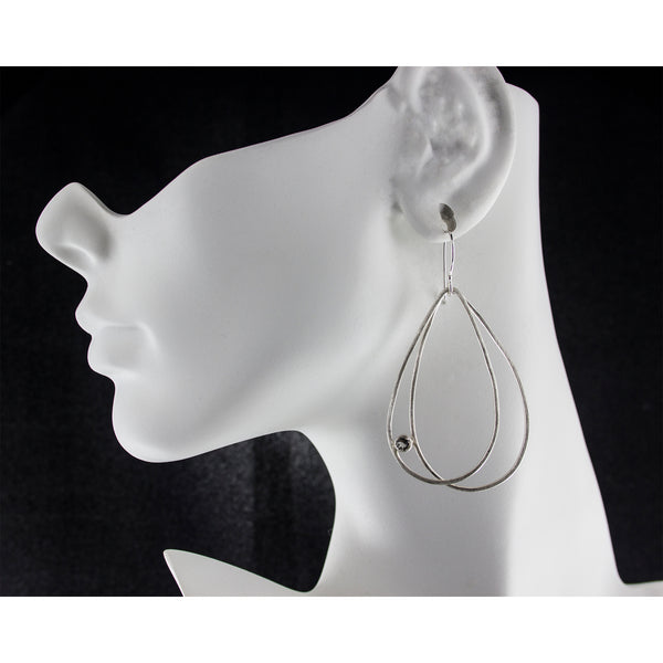 Large sterling silver double teardrop earrings with gemstones on model by eko jewelry design