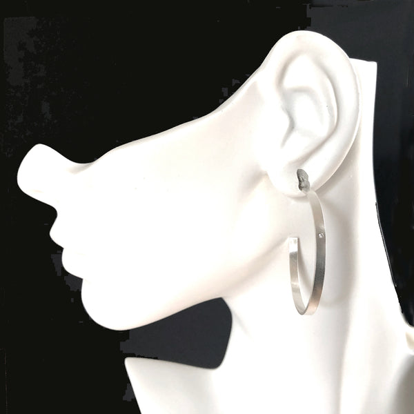 Large starling silver hoop earrings with gemstones by eko jewelry design, Novella on model