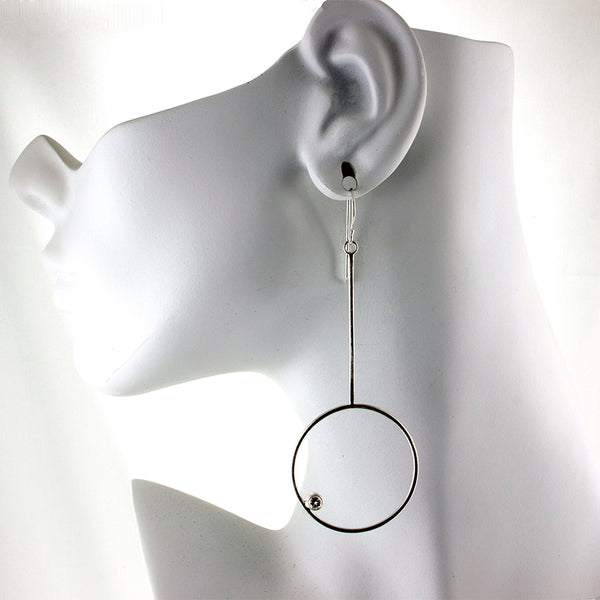Long sterling silver hoop earrings with gemstones by eko jewelry design on model