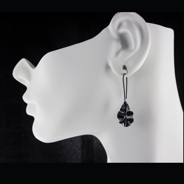 Oxidized sterling silver leaf earrings by eko jewelry design, Sierra on model