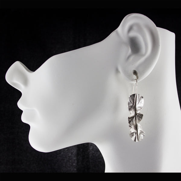 Modern rustic sterling silver leaf earrings by eko jewelry design, Kiona on model