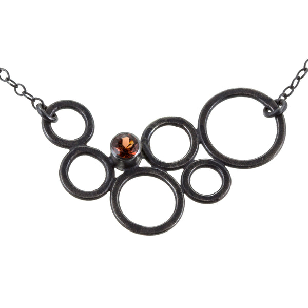 sterling silver circle necklace with garnet by eko jewelry design, Dawn