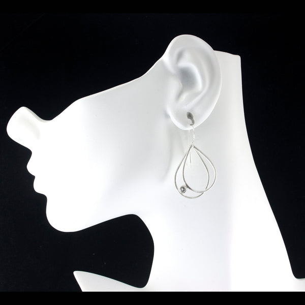 Sterling silver double teardrop earrings with gemstones on model by eko jewelry design