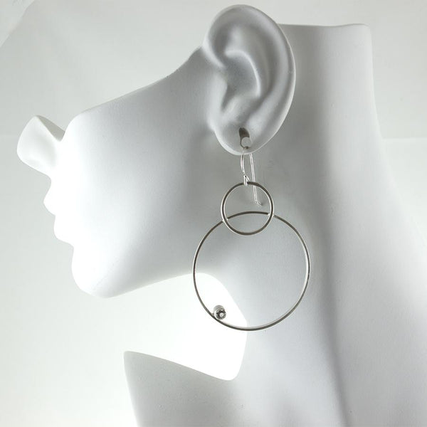 Large sterling silver hoop earrings with gemstones by eko jewelry design on model