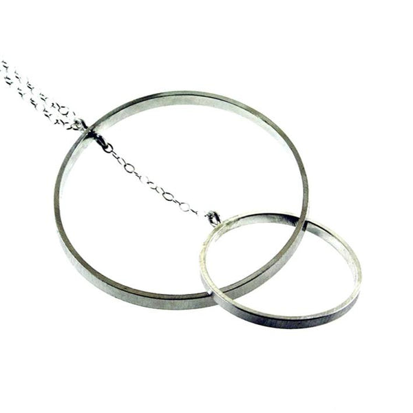 Intersecting large sterling silver hoop necklace by eko jewelry design