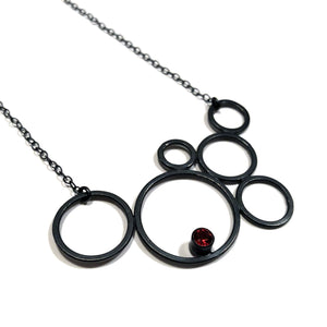sterling silver circle necklace with garnet by eko jewelry design, Zefira