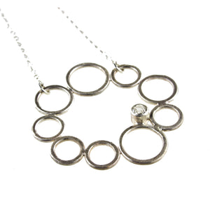 sterling silver circle necklace with a gemstone by eko jewelry design, Vespera