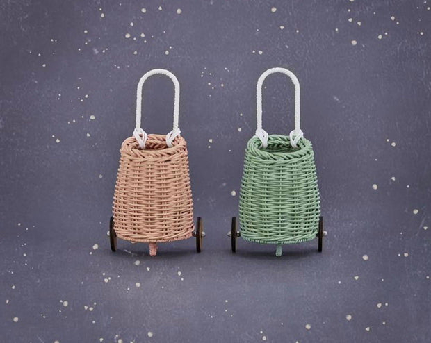 "Our beloved Doll Luggy now comes in Rose! Measuring 8.7"", the Doll Luggy is a miniature version of our coveted Luggy Basket, made especially for your kiddo's favorite doll or teddy. Like the original Luggy, this toy cart is made from handwoven Rattan, featuring two wooden wheels and a handle. A little caddy for all things small, from pencils and coins, to shells and more!    Available in Rose, Mint and Natural - which Doll Luggy will you choose?"