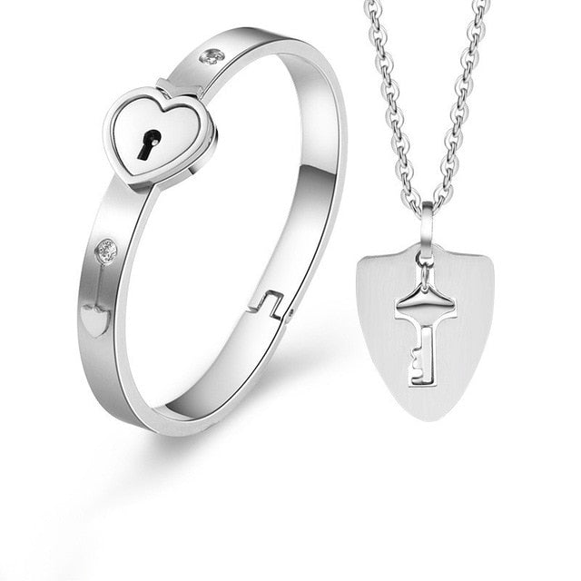 Beautiful Silver Concentric Lock Key Couple Bracelet and Necklace Set On Sale