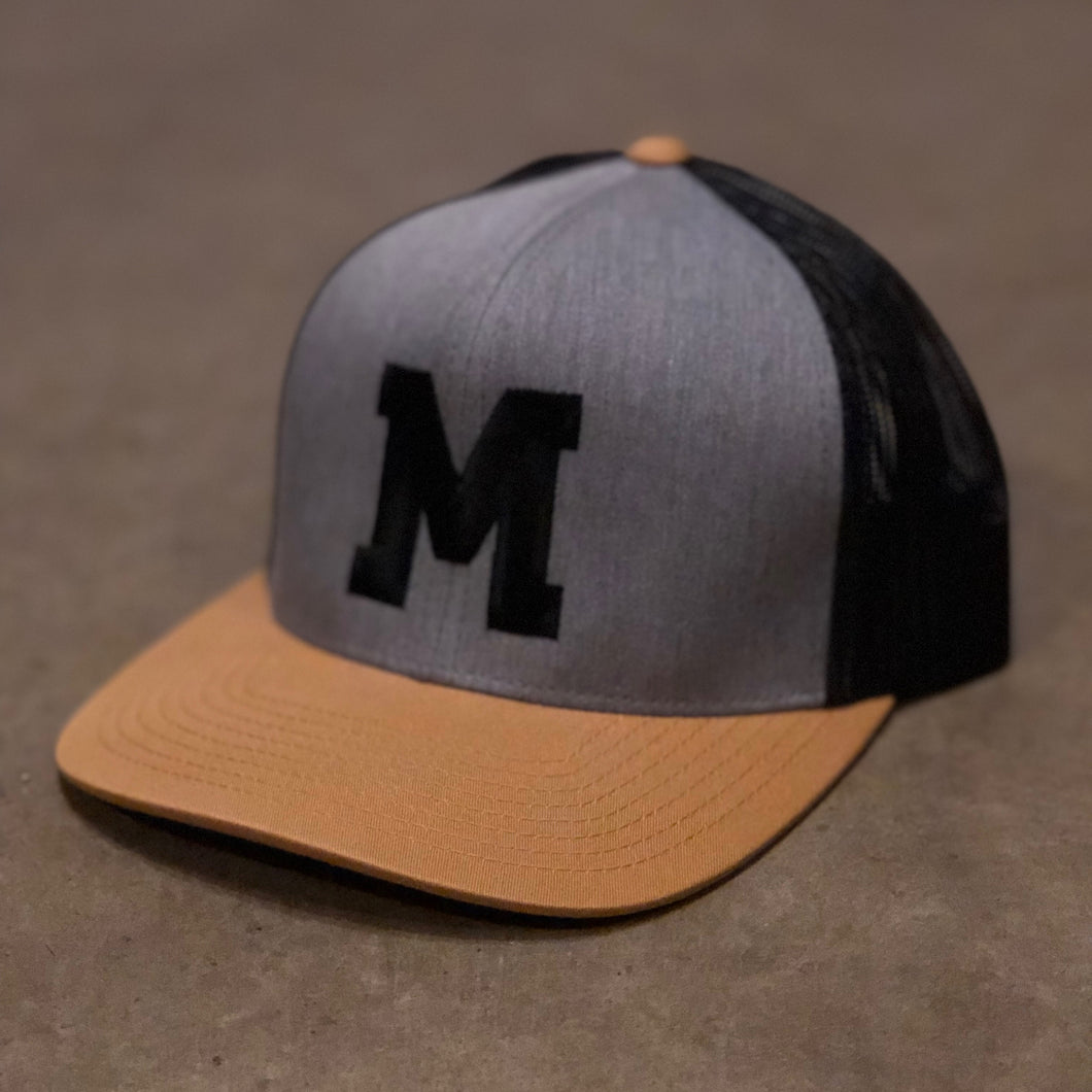 -M- Trucker Hat-Heather/Black/Gold