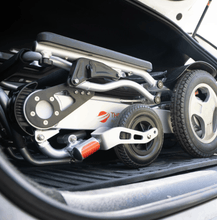 Folded in trunk of car - CITY Electric Wheelchair By Travel Buggy | Wheelchair Liberty