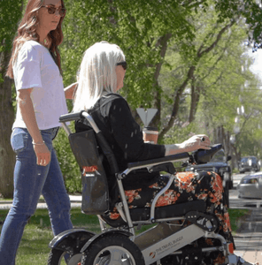 Side View of Woman Using CITY Electric Wheelchair By Travel Buggy | Wheelchair Liberty