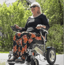 Woman using - CITY Electric Wheelchair By Travel Buggy | Wheelchair Liberty