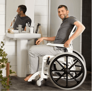CLEAN Self-Propelled Shower with 24 Inch Rear Wheels - Guy In Bathroom