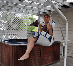 LIfting woman onto an above ground jacuzzi using Super Power EZ Above-Ground Pool lift by Aqua Creek | Wheelchair Liberty