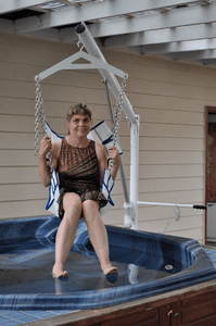 Woman above a jacuzzi using Super Power EZ Above-Ground Pool lift by Aqua Creek | Wheelchair Liberty