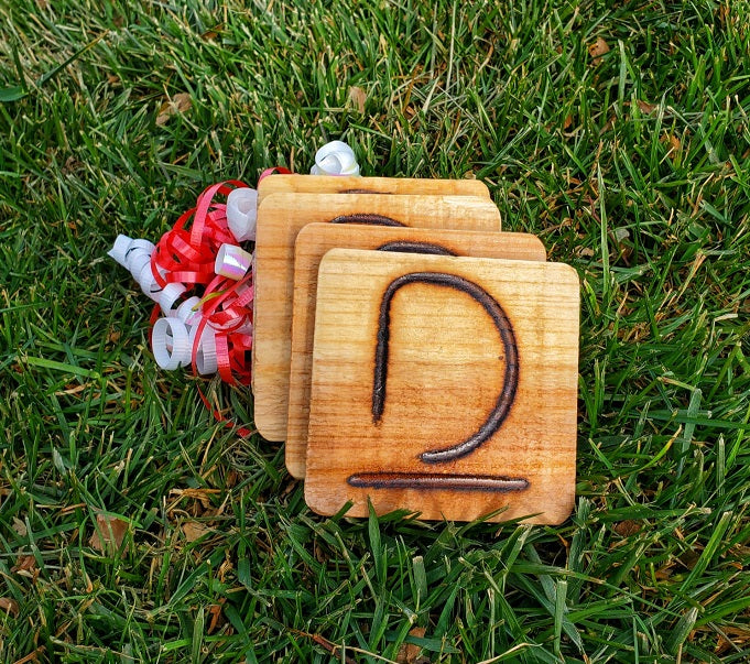 Branded wooden coasters from D&D Beef in Nebraska