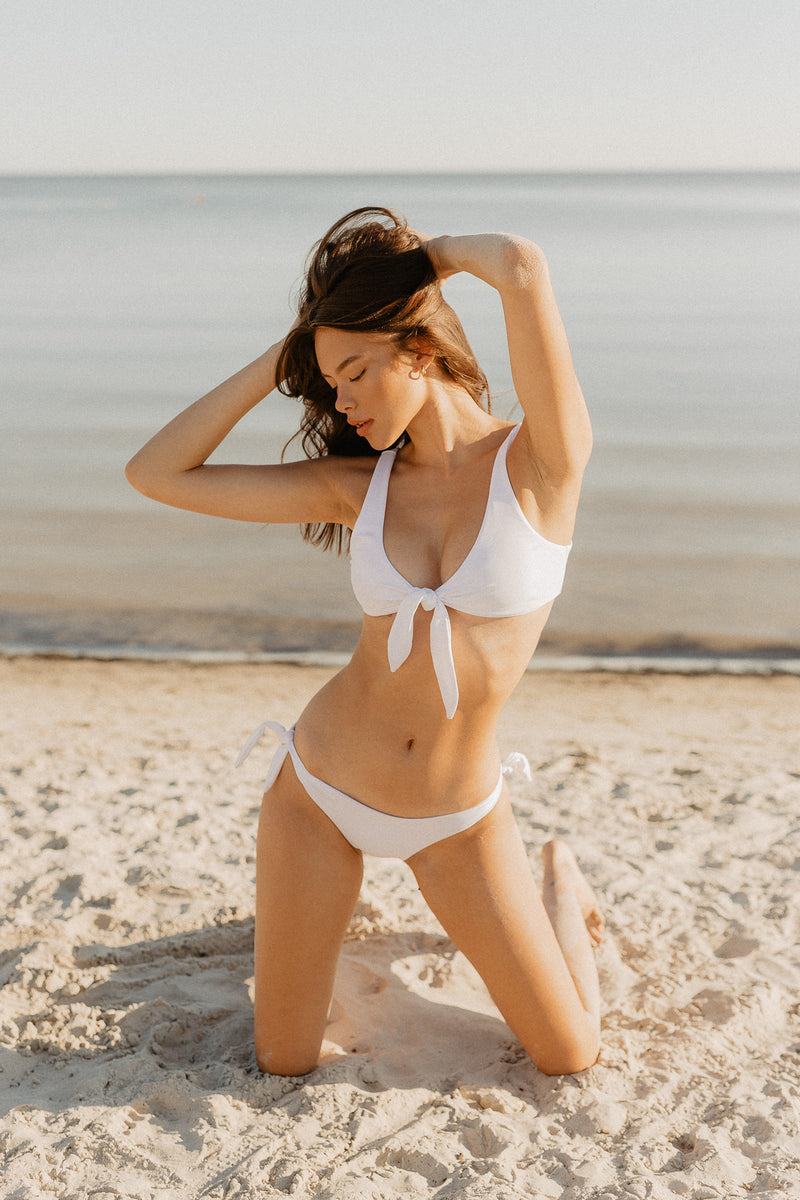 Model Cam Kangas in Canadian swimwear brand Prairie Swim cute white, adjustable, mix and match, tie-side bikini bottom with cheeky coverage