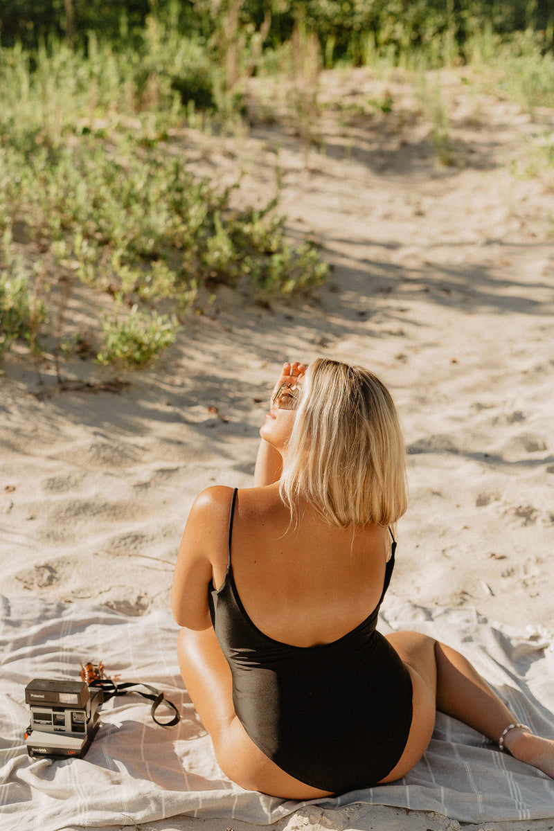 Canadian influencer Nicole Zajac wears Canadian swim brand Prairie Swim chic black low back one piece bathing suit