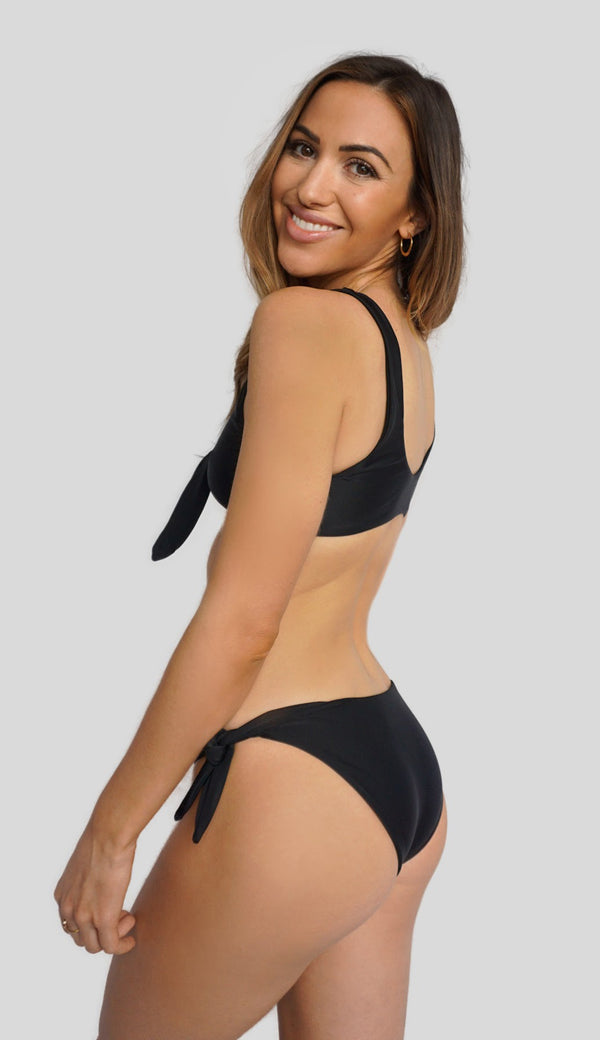 Alexandra Rabbitte wears new Canadian swimsuit brand, Prairie Swim. Black adjustable tie-side cheeky coverage bikini bottoms. Mix and match.