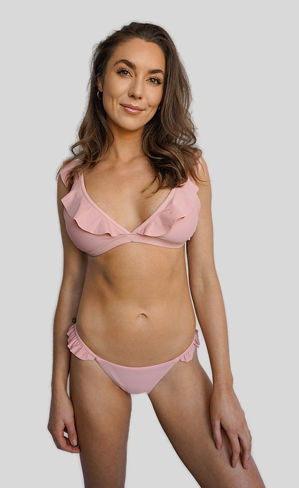 Carling Liski in Canadian swimwear brand Prairie Swim pink adjustable triangle bikini top with ruffles and clasp back