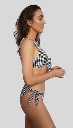 Carling Liski wears Canadian swimsuit brand Prairie Swim. Designed in Toronto. Adjustable tie-side mix and match cheeky coverage cute gingham print bikini bottom