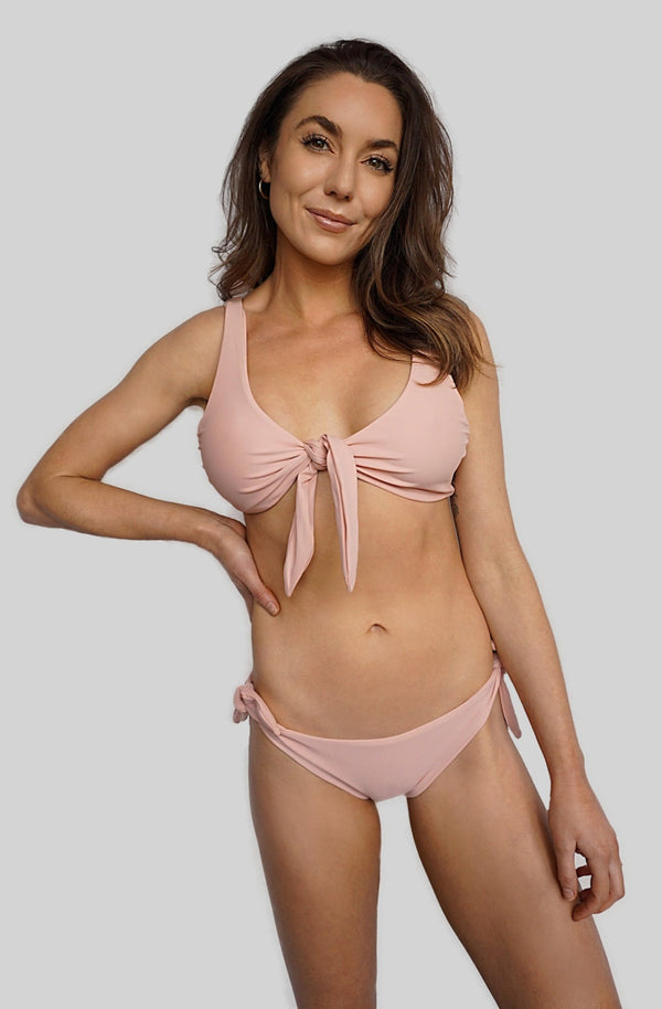 Carling Liski in Canadian swimsuit brand Prairie Swim cute pink adjustable, mix and match, tie-front bikini top with supportive straps for all bust sizes