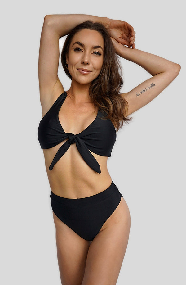 Carling Liski wears Canadian swimwear brand Prairie Swim designed in Toronto. Classic black figure flattering high waist bikini bottom with high cut legs