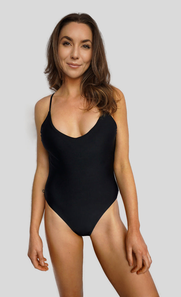 Carling Liski wears Canadian swim brand Prairie Swim chic black low back one piece bathing suit