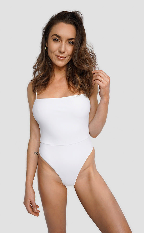 Carling Liski wears Canadian swimsuit brand Prairie Swim designed in Toronto. Classy white straight-cut neckline one piece swimsuit with figure flattering cinched waist, adjustable straps and high cut legs,